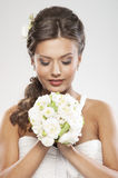 Portrait of a young brunette bride holding flowers Stock Photography