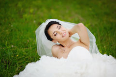 Portrait of young brunette bride in spring garden Stock Photo