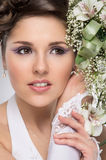 Portrait of a young brunette bride in a white dress Royalty Free Stock Images