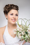 Portrait of a young brunette bride in a white dress Royalty Free Stock Photography