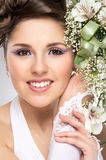 Portrait of a young brunette bride in a white dress Royalty Free Stock Photos