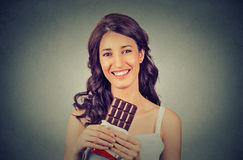 Portrait of a young brunette chocolate loving woman. Diet concept Stock Photos
