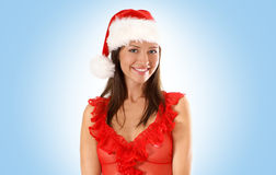 Portrait of a young brunette in a Christmas hat Stock Photo