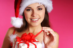 Portrait of a young brunette in a Christmas hat Stock Photos