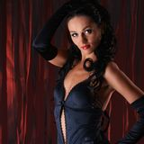 Portrait of a young brunette in dark lingerie Royalty Free Stock Images
