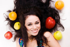 Portrait of a young brunette with fresh fruits Stock Photo
