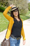 Portrait of young brunette girl with  hat in park. A portrait of young brunette girl with  hat in park Stock Photography
