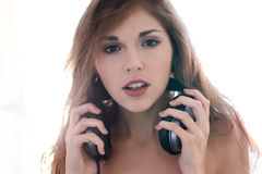 Portrait of a young brunette girl with headphones Stock Photos