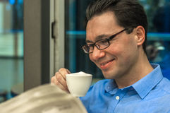 Portrait of young brunette hair businessman sitting in a coffee royalty free stock photography