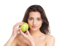 Portrait of a young brunette holdig an apple Royalty Free Stock Image