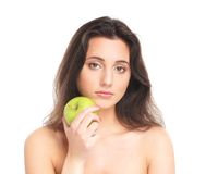 Portrait of a young brunette holdig an apple Royalty Free Stock Photo
