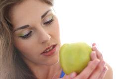 Portrait of a young brunette holding an apple Royalty Free Stock Photography