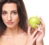 Portrait of a young brunette holding an apple Royalty Free Stock Photos