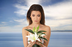 Portrait of a young brunette holding a flower Stock Photos