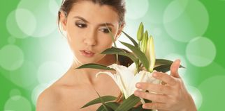 Portrait of a young brunette holding a flower Royalty Free Stock Photography