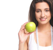 Portrait of a young brunette holding a fresh apple Stock Photo
