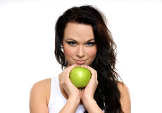 Portrait of a young brunette holding a green apple Stock Photography