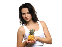Portrait of a young brunette holding a pineapple Stock Image