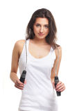 Portrait of a young brunette with a jumping rope Stock Images