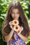 Portrait of a young brunette little girl with peach Royalty Free Stock Photos