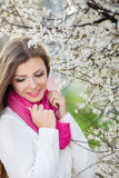 Portrait of a young brunette in a lush garden Royalty Free Stock Photo