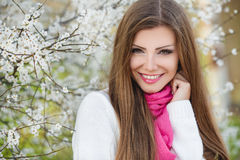 Portrait of a young brunette in a lush garden Stock Images