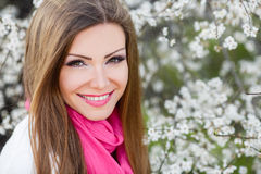 Portrait of a young brunette in a lush garden Royalty Free Stock Image