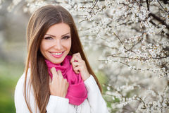 Portrait of a young brunette in a lush garden Royalty Free Stock Images