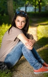 Portrait of a young brunette in the park Stock Photo