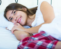 Portrait of young brunette posing in home bed Stock Photography