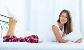Portrait of young brunette posing in home bed Royalty Free Stock Photography
