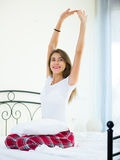 Portrait of young brunette posing in home bed Royalty Free Stock Image