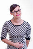 Portrait of a young brunette secretary / teacher or a business woman Royalty Free Stock Images