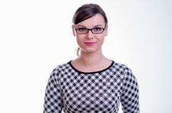 Portrait of a young brunette secretary / teacher or a business woman Royalty Free Stock Image