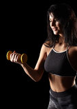 Portrait of a young brunette sporty fitness woman with dumbbell Stock Image