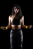 Portrait of a young brunette sporty fitness woman with dumbbell Stock Photos