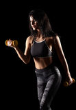 Portrait of a young brunette sporty fitness woman with dumbbell Stock Photo