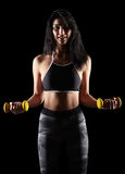 Portrait of a young brunette sporty fitness woman with dumbbell Stock Photography