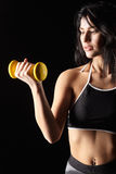 Portrait of a young brunette sporty woman with dumbbell in hand Royalty Free Stock Photos