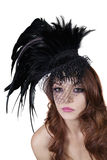 Portrait of young brunette wearing feathered veil over white background Stock Photos
