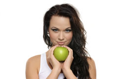 Portrait of a young brunette woman with an apple Royalty Free Stock Image