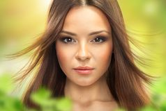 Portrait of a young brunette woman. stock photo