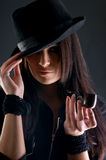 Portrait of a young brunette woman in a black hat Royalty Free Stock Images