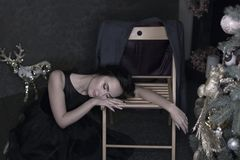 Portrait of young brunette woman in evening black dress asleep o royalty free stock photo