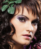 Portrait of a young brunette woman in a makeup Stock Images