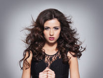 Portrait of a young brunette woman in makeup Stock Photos