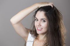 Portrait of a young brunette woman making faces with different e Royalty Free Stock Images