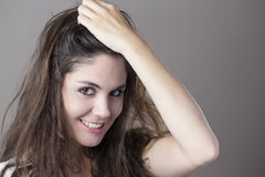 Portrait of a young brunette woman making faces with different e Stock Images