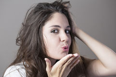Portrait of a young brunette woman making faces with different e Stock Image