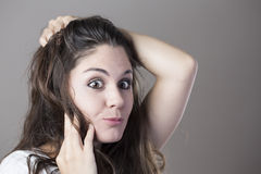 Portrait of a young brunette woman making faces Stock Image